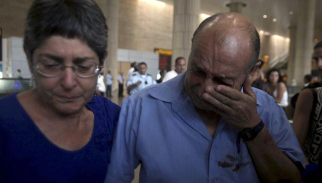 De regreso. La mayoría de los sobrevivientes del atentado volvieron ayer a Israel (AP).
